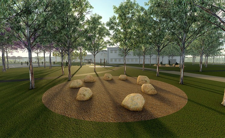 Courtyard with stone circle surrounded by trees